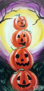 Stack of Jack O' Lanterns at Creatively Uncorked https://creativelyuncorked.com/