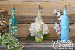 Wine Bottles with Lights at Creatively Uncorked https://creativelyuncorked.com